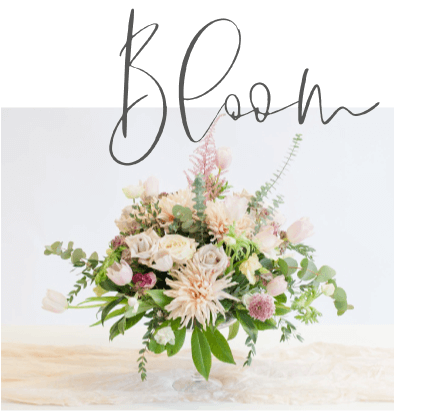 table flower arrangement with eucalyptus tulips and roses