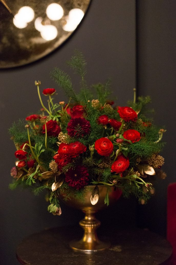 christmas flower arrangement in red and gold for a party