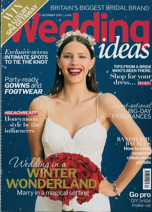 smiling bride holding a red roses compact bouquet on the cover of wedding ideas magazine