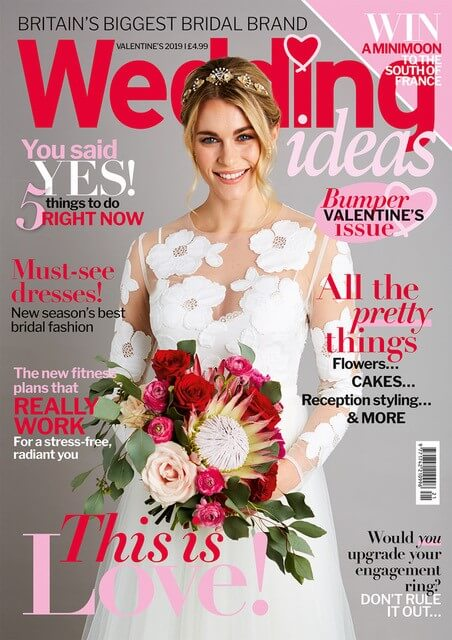 Wedding Ideas Magazine St Valentine edition cover, with a smiling bride holding our bouquet including protea, ranunculus and red roses