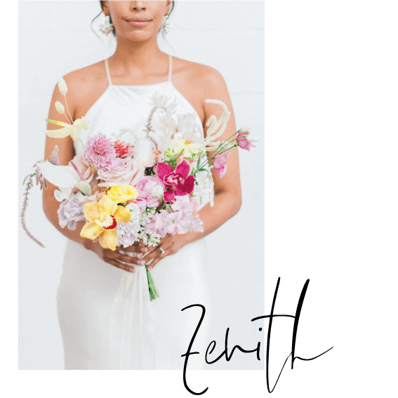 Bride holding a bespoke bridal bouquet with roses, orchids, dry ruscus, lisianthus and ranunculus