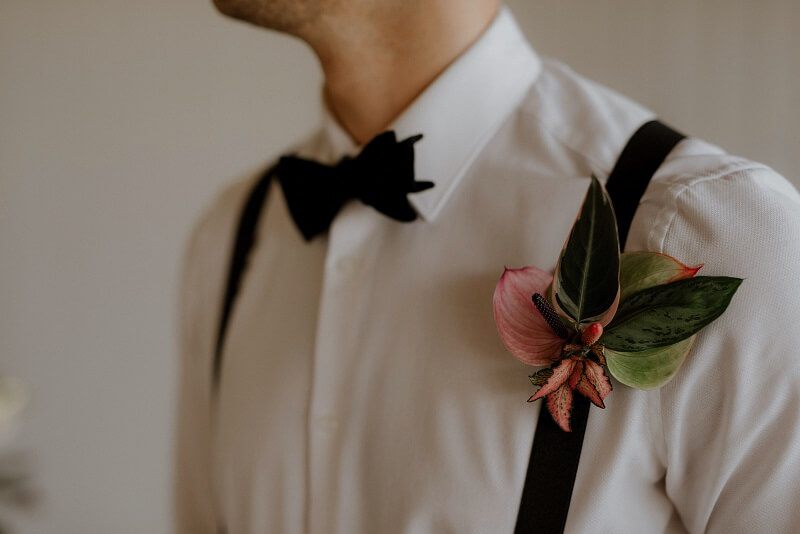 botanical buttonhole with plant leaves