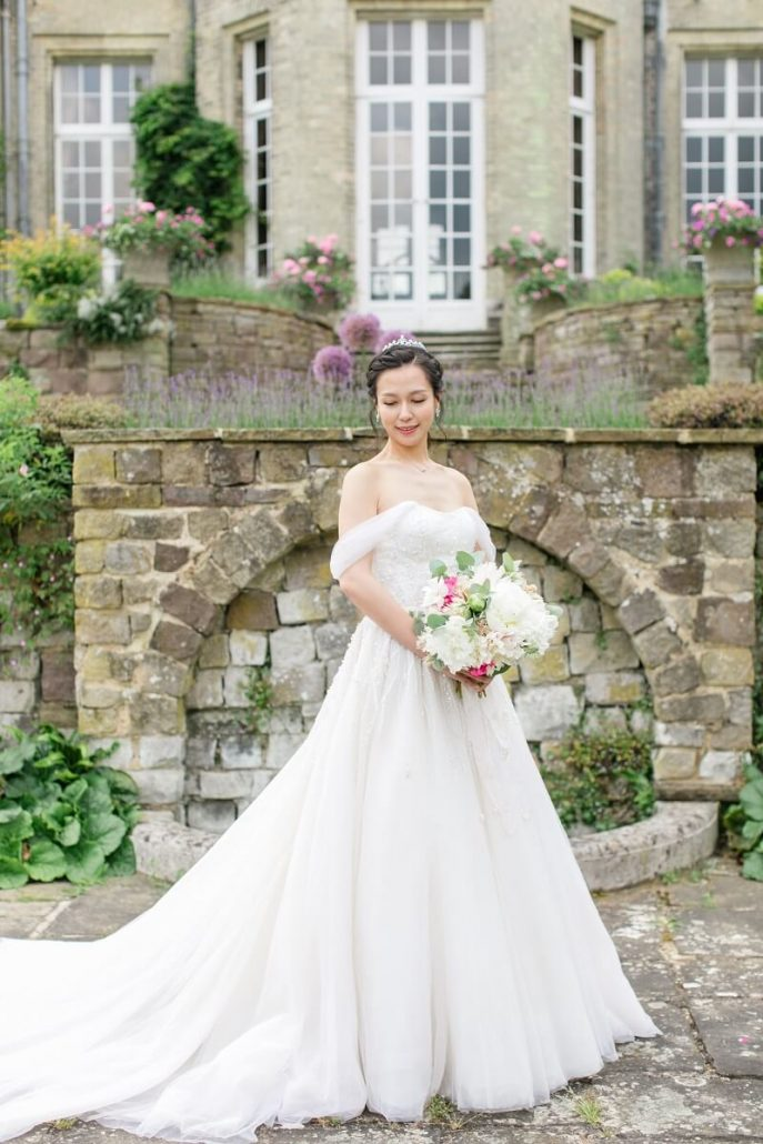 bride with peonies bouquet at Hedsor House