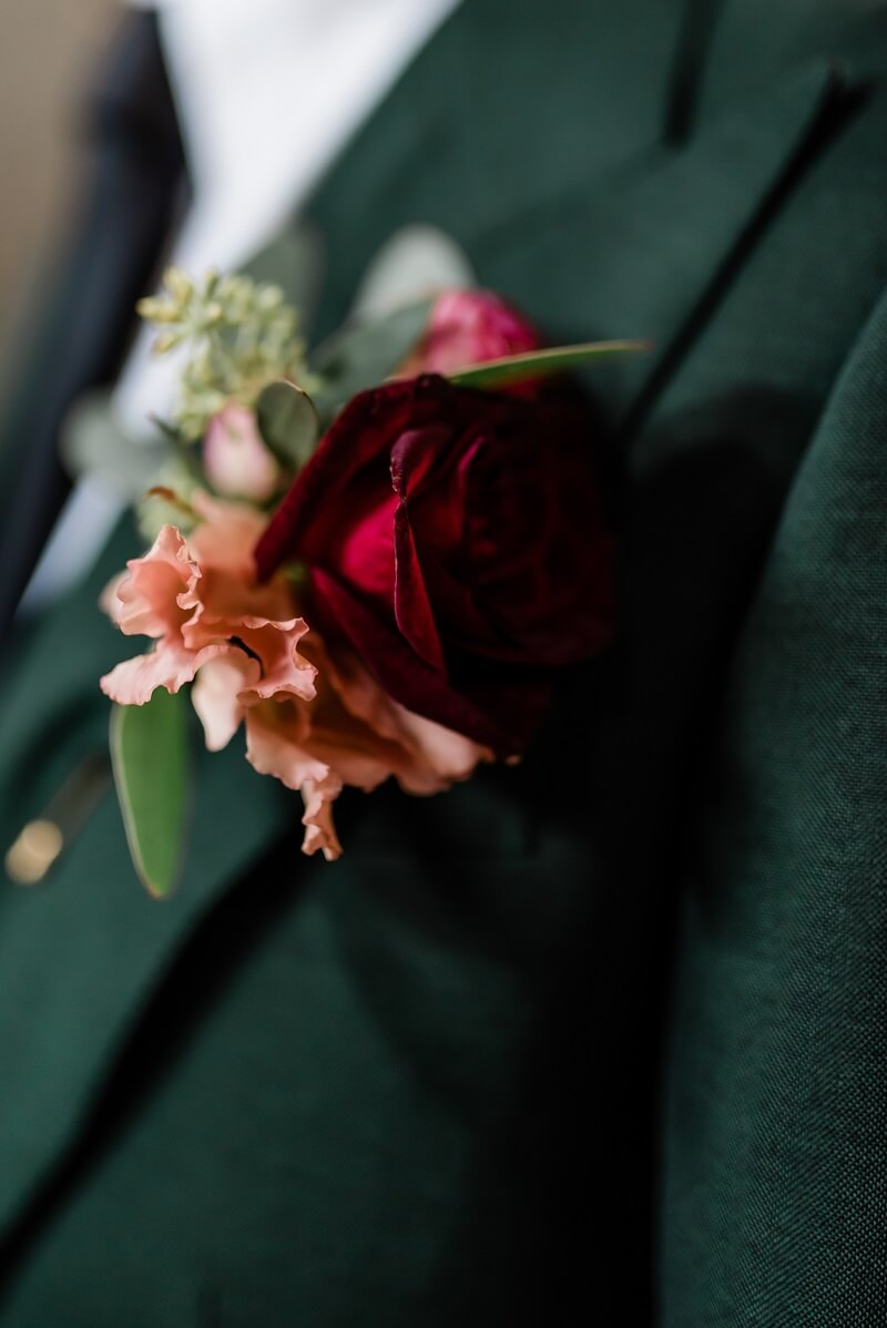 peach and red buttonhole for a ceremony at The Asylum, London
