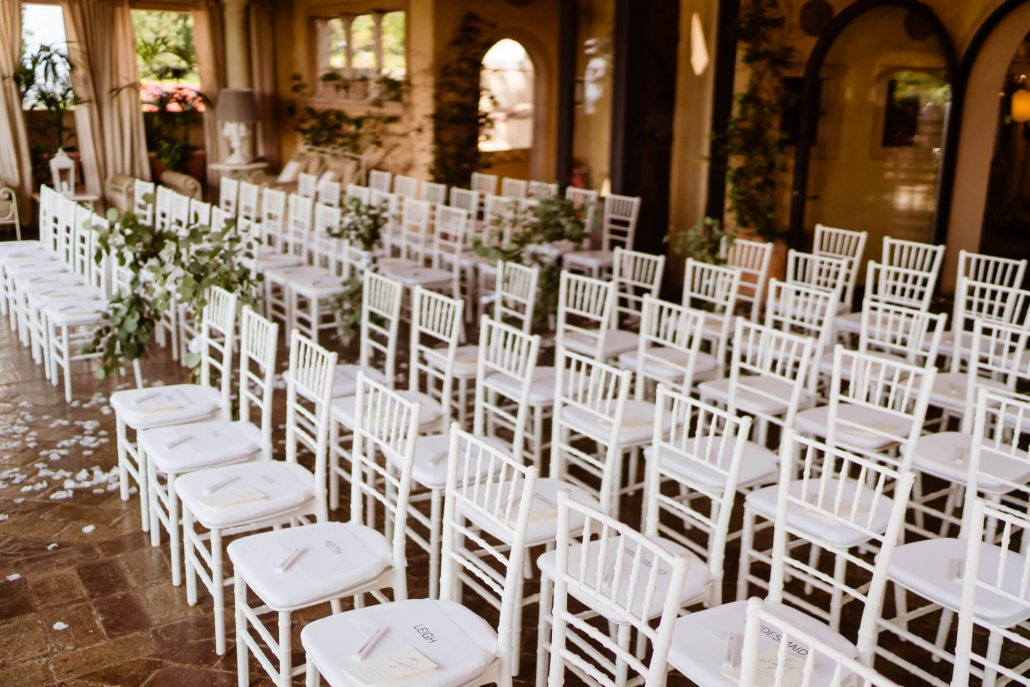 white chairs set up for a ceremony in Tuscany