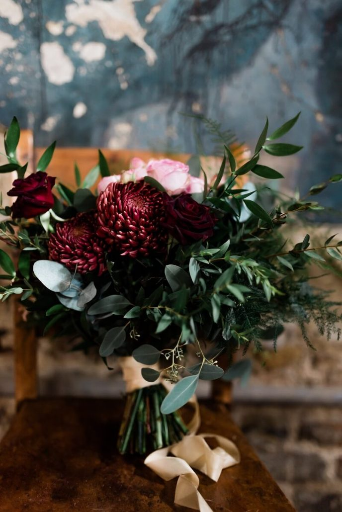 dark red and greenery bouquet for ceremony at the Asylum in London
