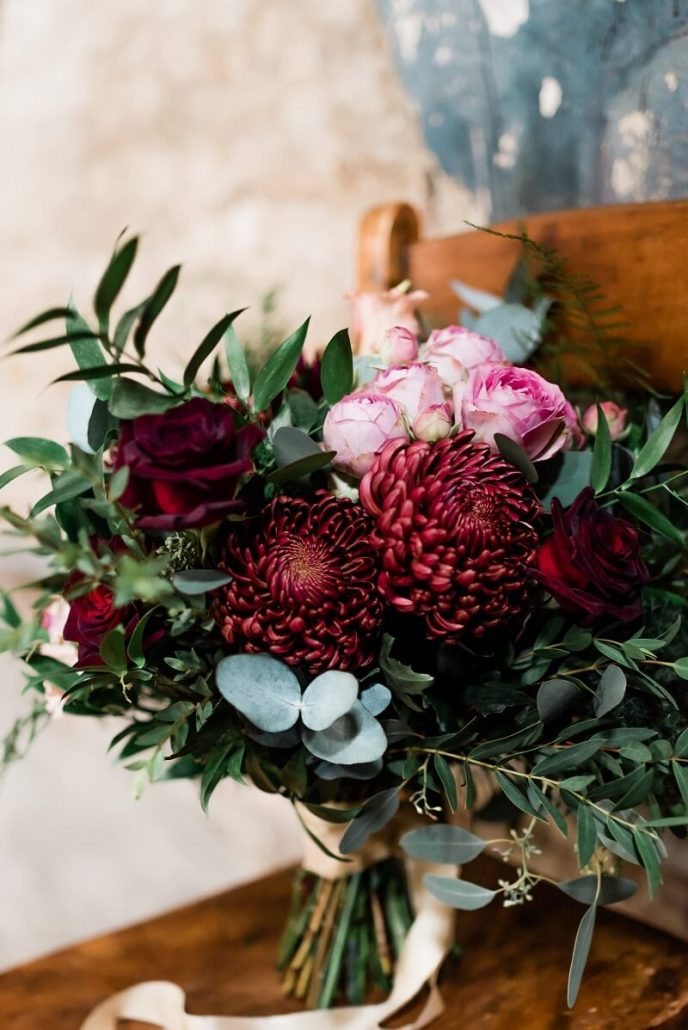 large red dahlia bouquet with ruscus for a wedding at the Asylum, London