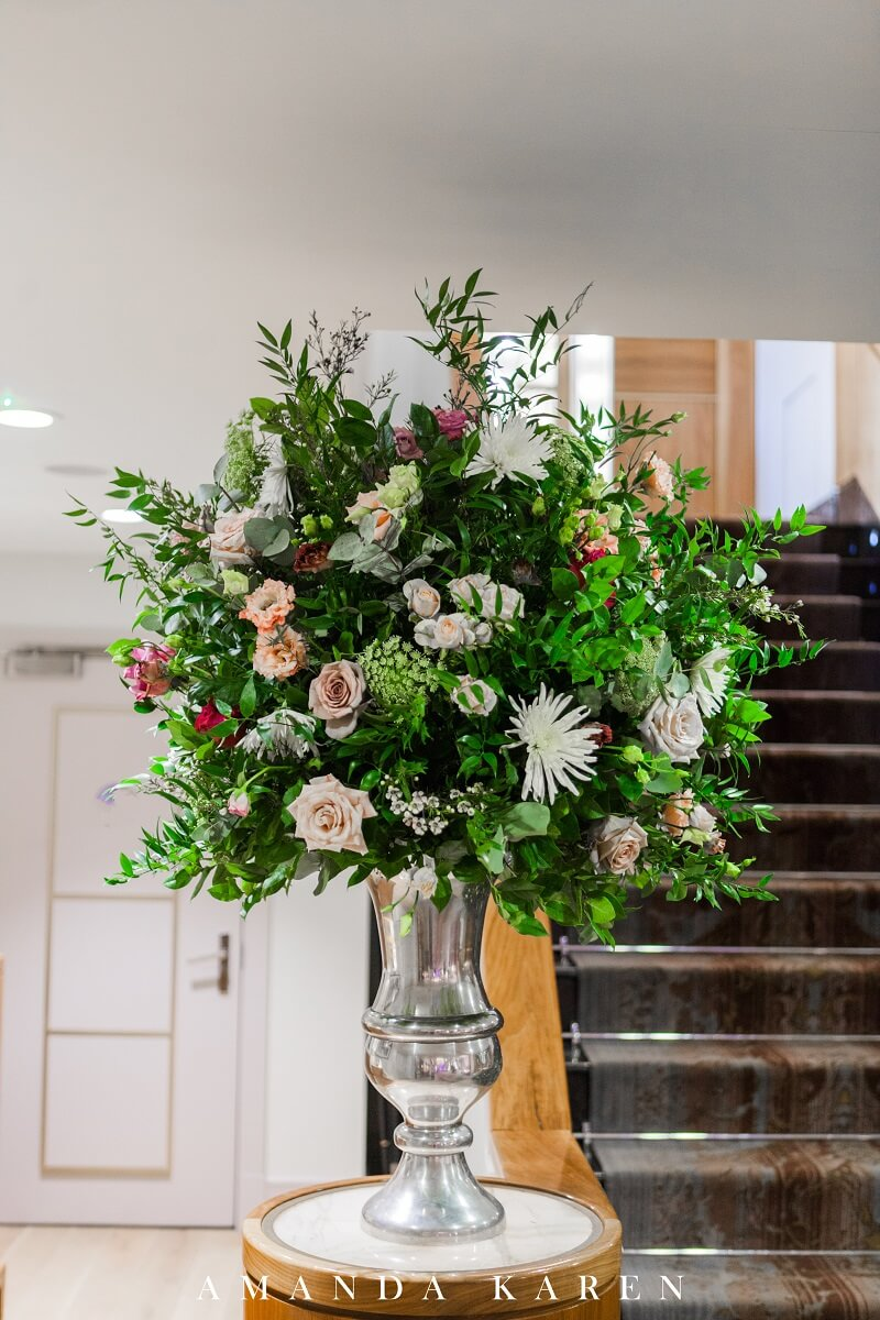 large flowers and foliage urn at the Sofitel St James Hotel in London
