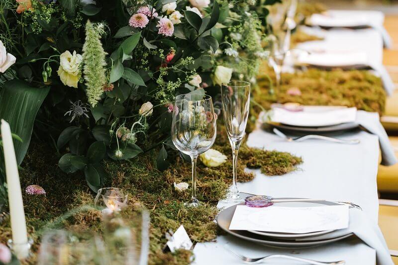 moss and flowers decoration on a wedding table at The Terrace On Piccadilly in London