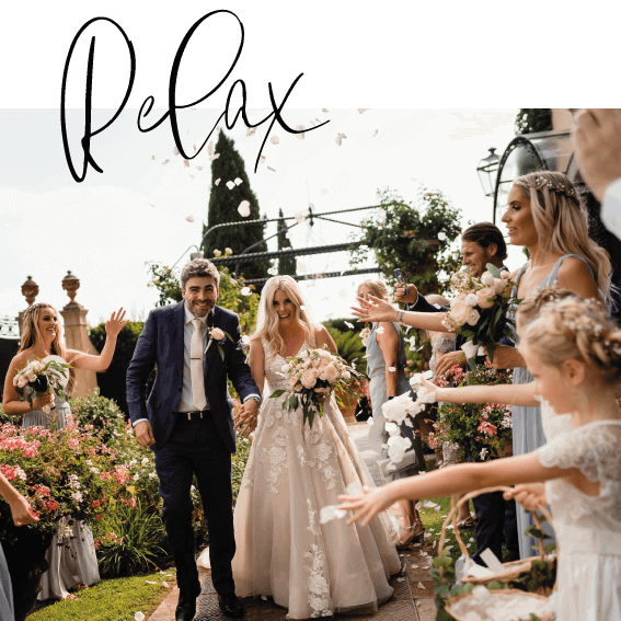couple after wedding ceremony during confetti shot in Tuscany