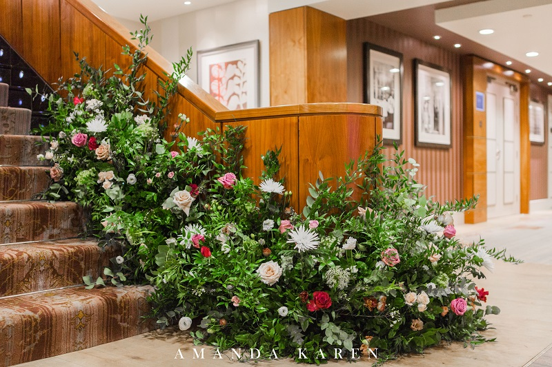 greenery and flowers staircase installation at the Sofitel St James hotel in London